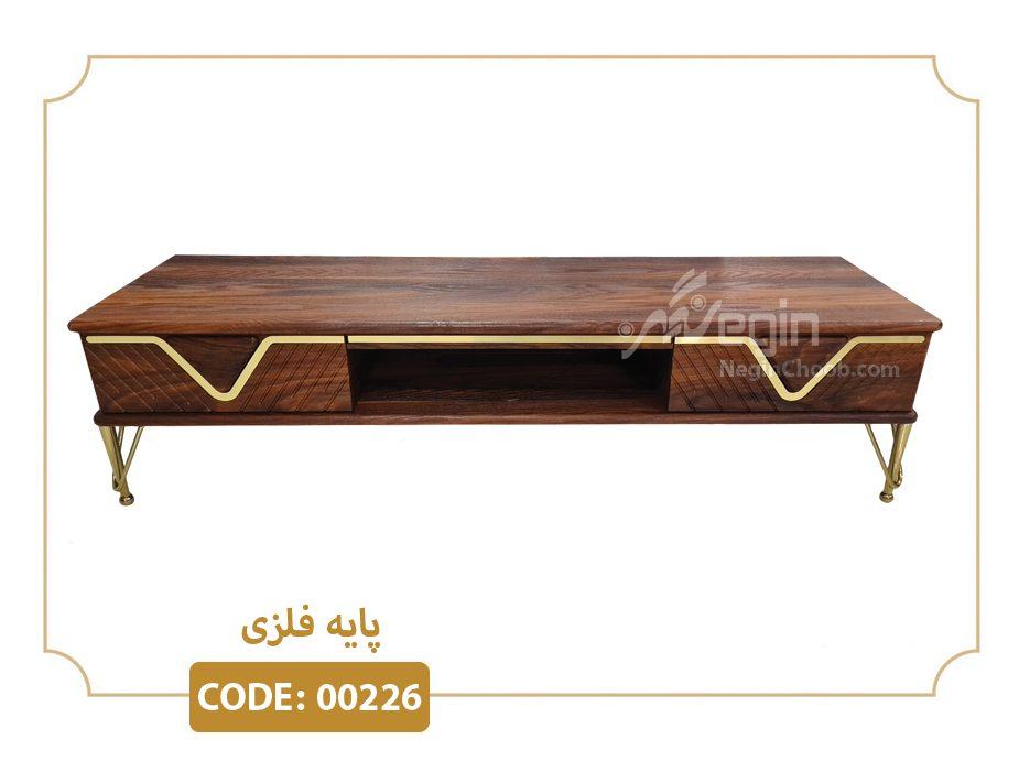 میز تلویزیون مدل 00226 بدنه MDF وکیوم پایه فلزی طلایی فورتیک